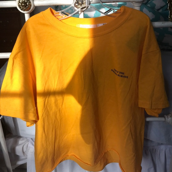 28d06082e Urban outfitters tops yellow only the strong survive shirt jpg 580x580 Only  the strong survive shirt